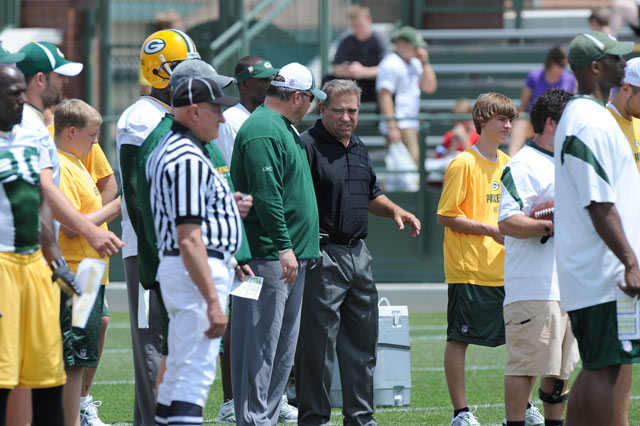 Dan Lauria and Packers Coach Mike McCarthy at practice on Lambeau Field.